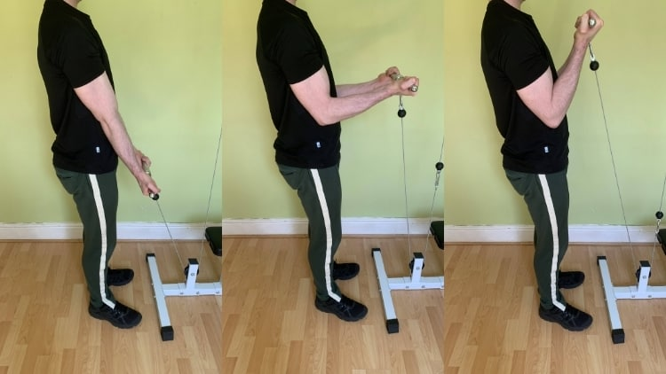 Man performing close grip cable curls for his biceps
