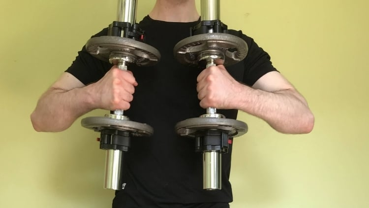 A man performing cross body curls with a hammer grip