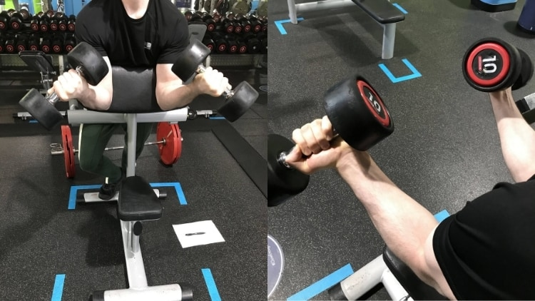 A man doing a DB spider curl exercise