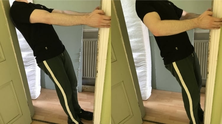 A man doing a door curl for his biceps