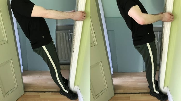 A man doing door curls for his biceps
