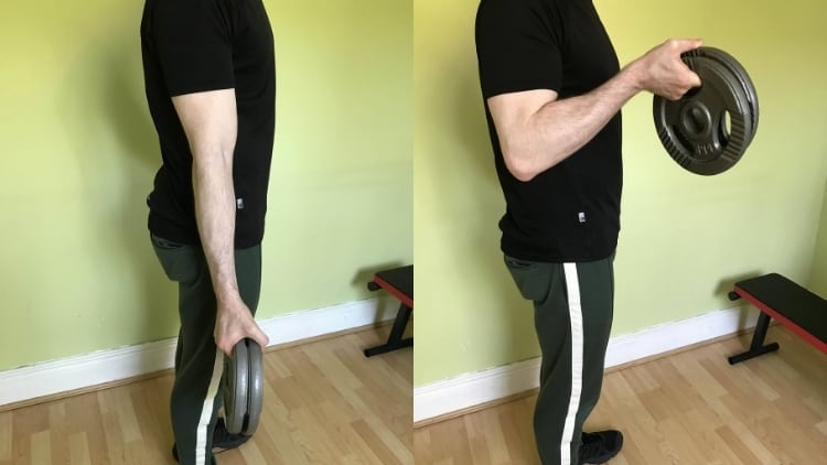 A man doing a double plate curl