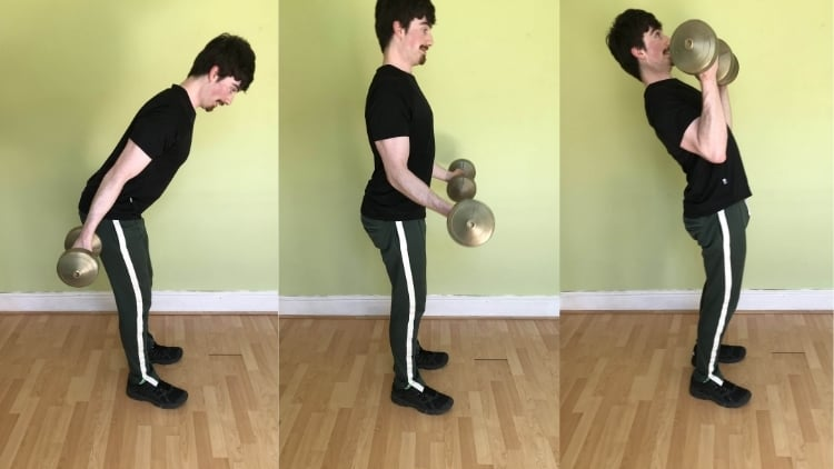 A man showing a common dumbbell bicep curl mistake: using momentum