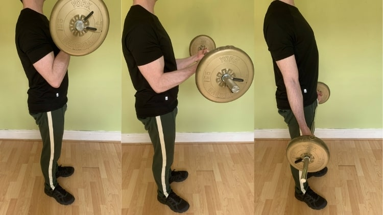 A man performing eccentric standing curls for his biceps