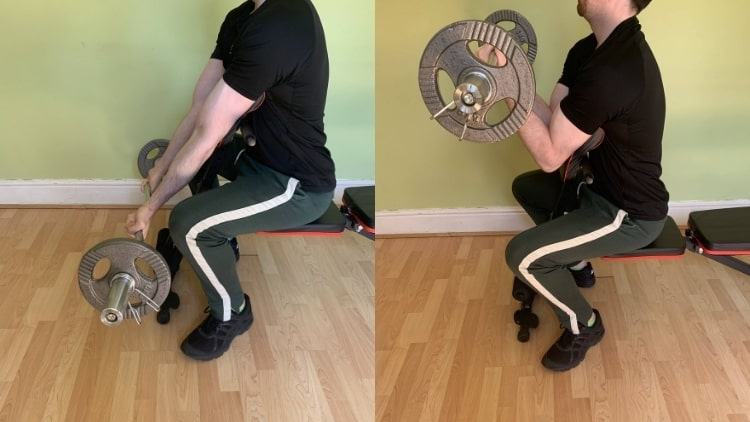 A man demonstrating how to do an EZ bar preacher curl for the biceps