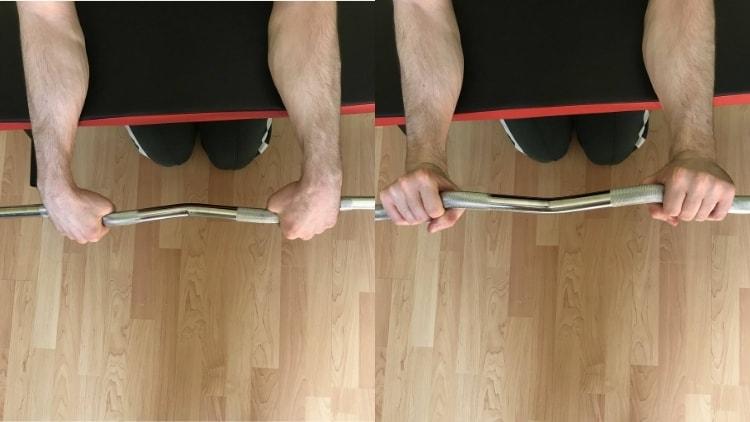A man performing an EZ bar reverse wrist curl
