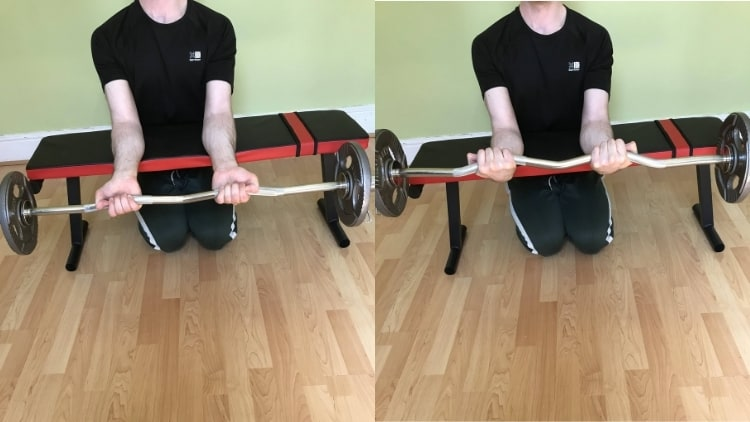 A man performing an EZ bar wrist curl for his forearms