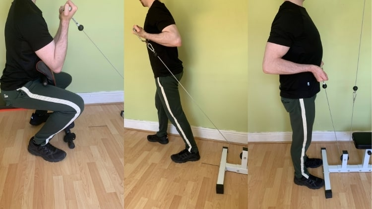 Man showing alternatives to EZ cable curls