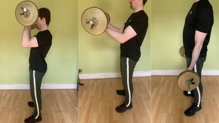 A man performing forehead curls for his biceps
