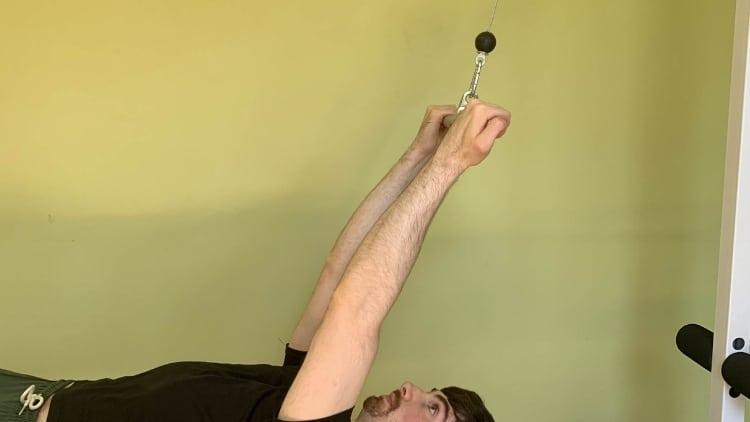 A man doing guillotine curls