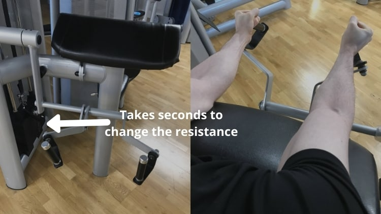 A man using the hammer curl machine at the gym