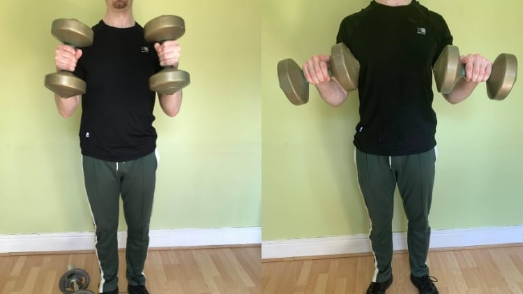 A man demonstrating the differences between hammer curls and reverse curls