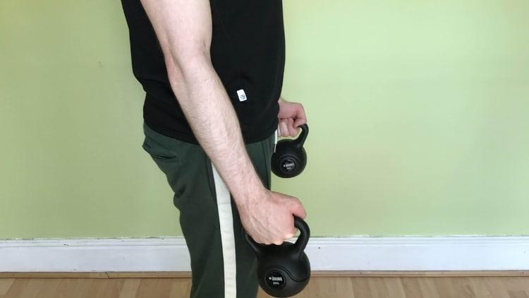 Man performing a hammer kettlebell curl