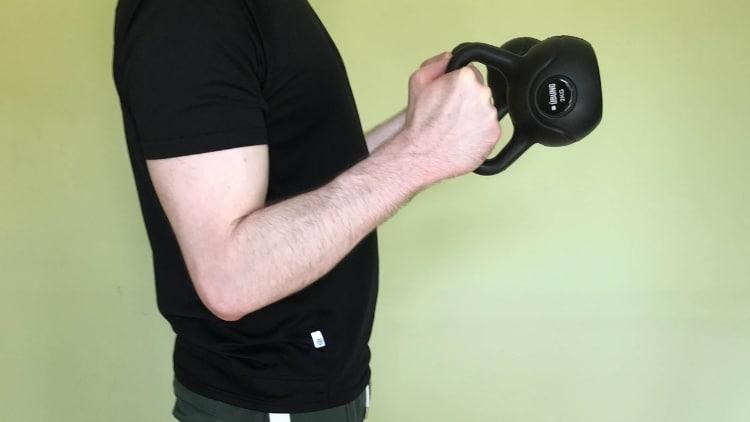 Man doing the hammer kettlebell curl
