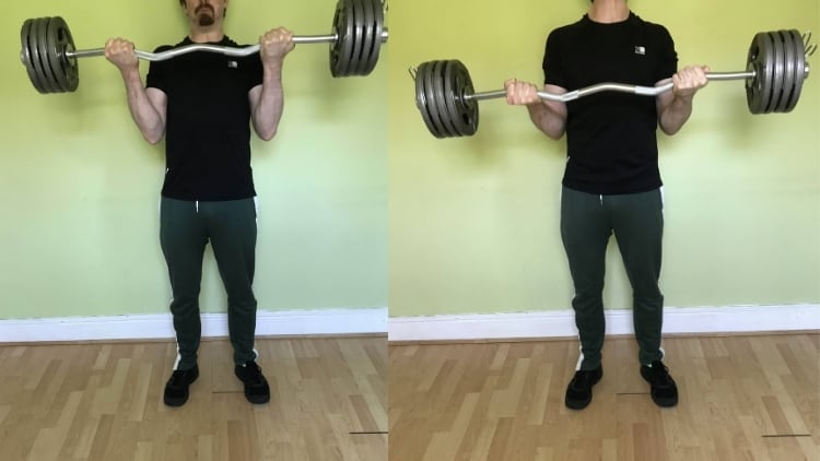 A man doing heavy negative curls for his biceps