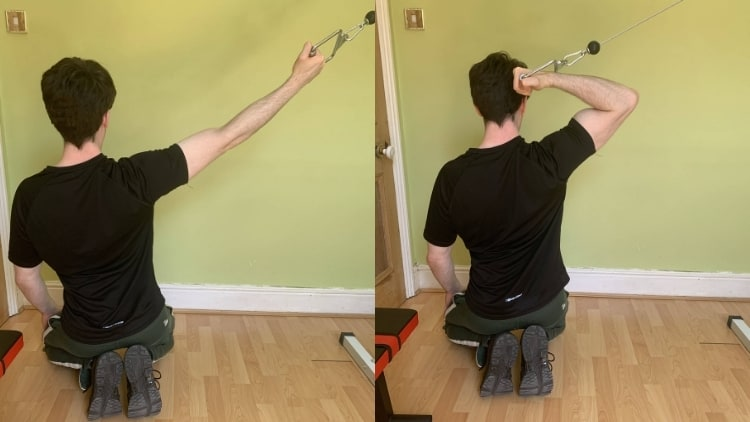 Man performing a high cable curl