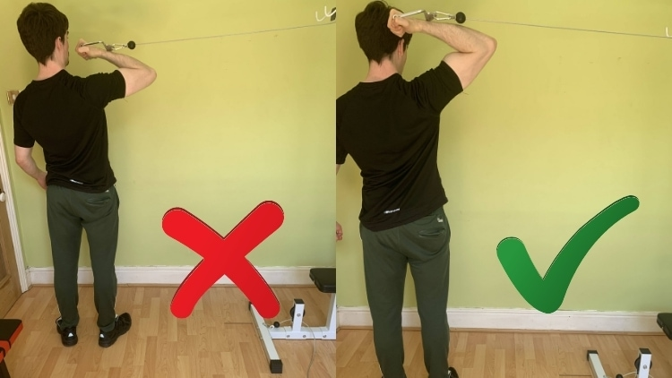 Man doing a high pulley cable curl for his biceps