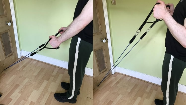 Man demonstrating how to do resistance band hammer curls