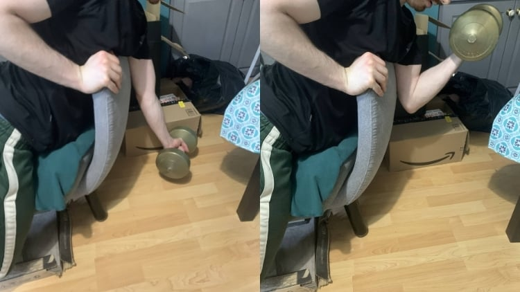 A man demonstrating how to do preacher curls at home without a bench