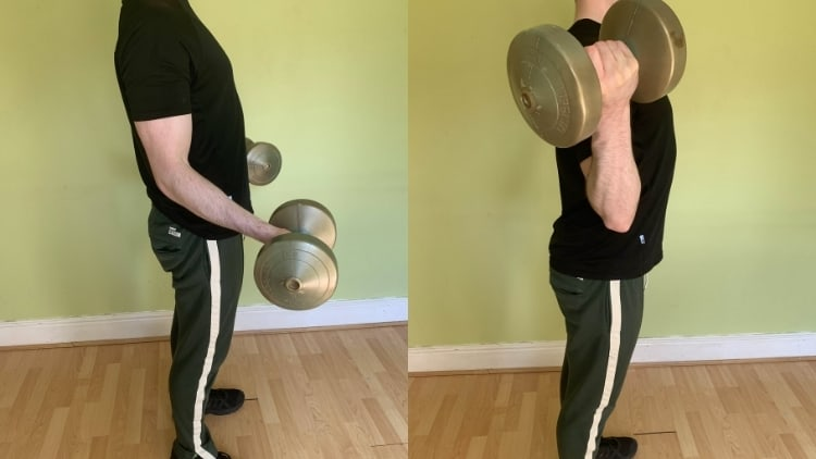 A man doing in and out bicep curls