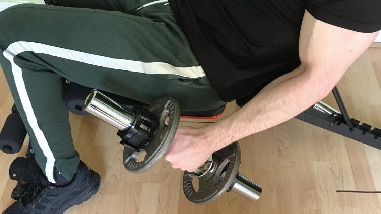 A man doing incline bench hammer curls