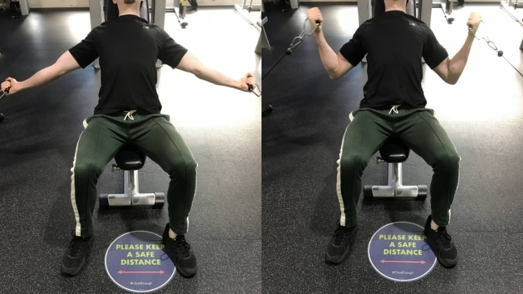 A man performing an incline cable curl for his biceps