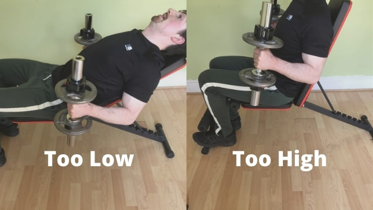 A man showing the incorrect bench angle for incline hammer curls