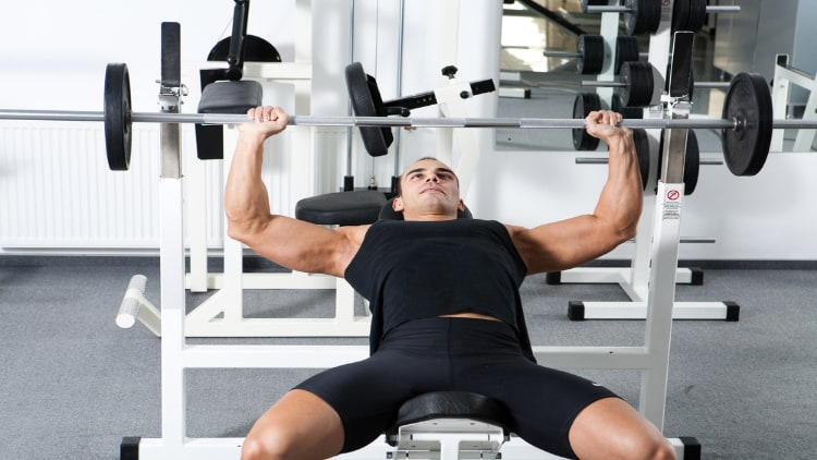 Man doing a barbell incline press