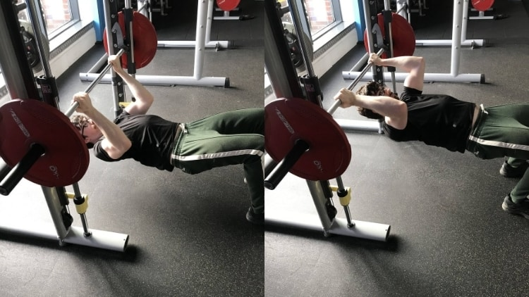 A man doing an inverted curl