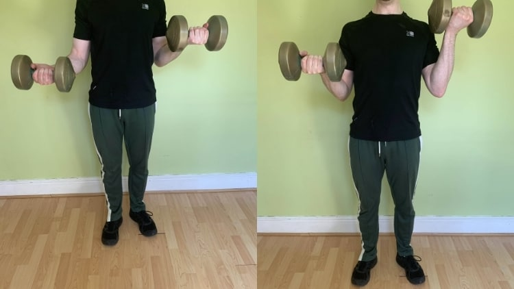 A man performing iso curl holds for his biceps