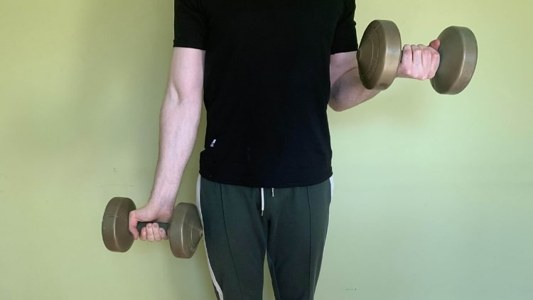 A man doing iso curls