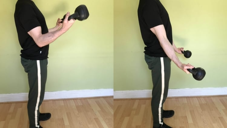 A man performing kettlebell curls for his biceps