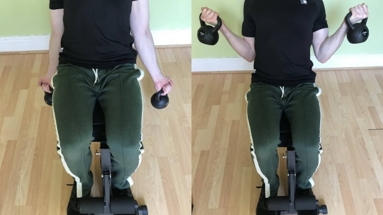 Man performing kettlebell incline curls for his biceps