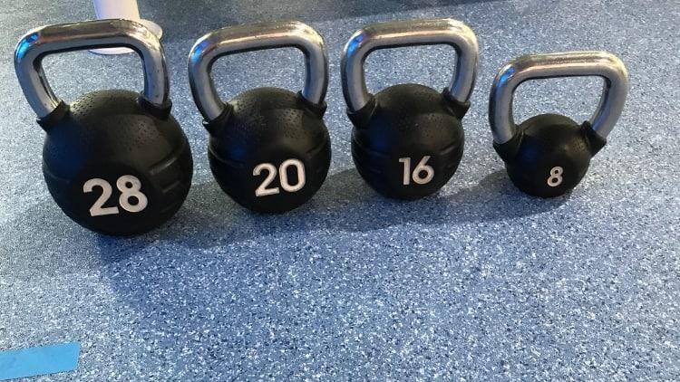 A set of kettlebells on the gym floor