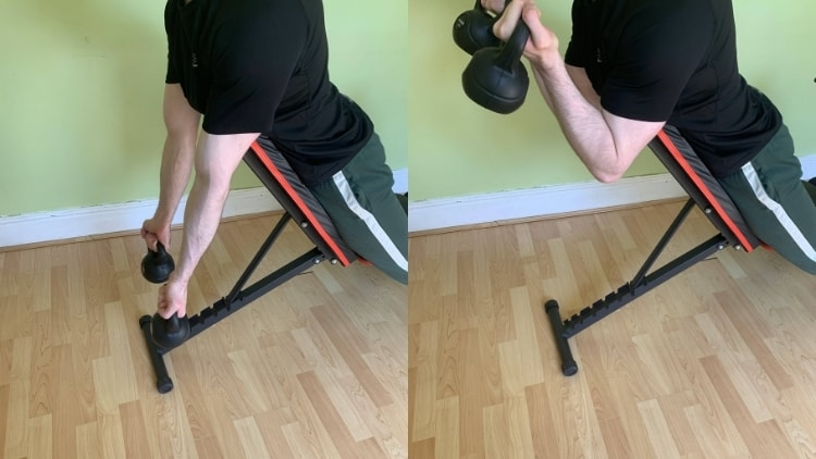 Man doing a kettlebell spider curl for his biceps
