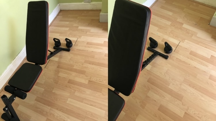 The setup for kettlebell spider curls: weights positioned at the end of the bench