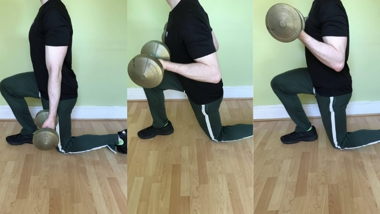 Man doing a lunge with bicep curl