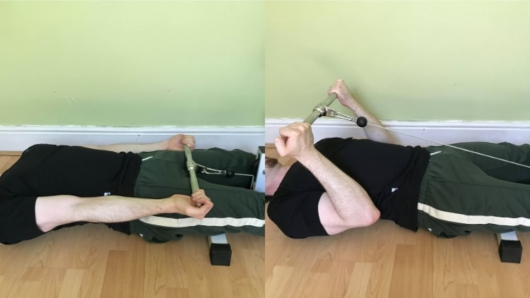 A man doing a lying cable bicep curl