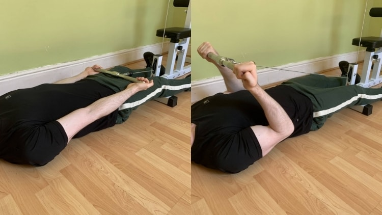 A man performing lying cable curls for his biceps