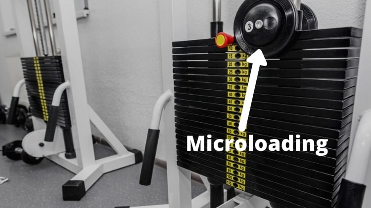 A cable machine microloaded with extra weight