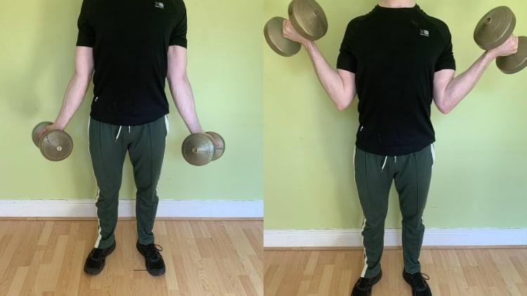 A man performing no money curls