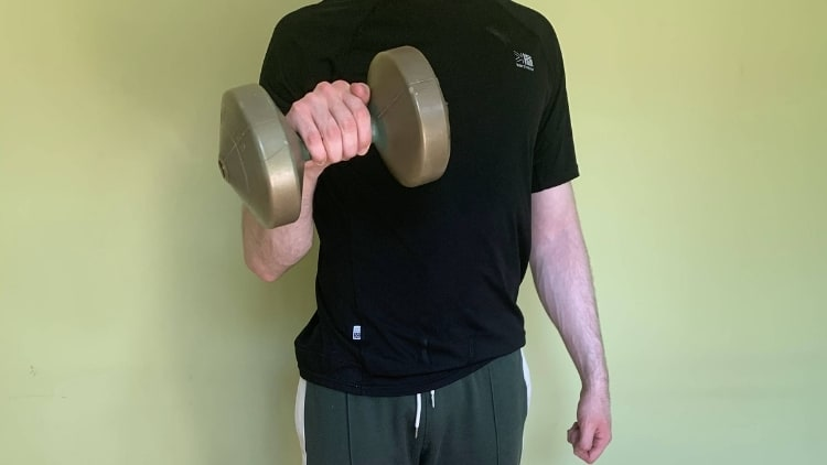 Man performing one arm dumbbell reverse curls