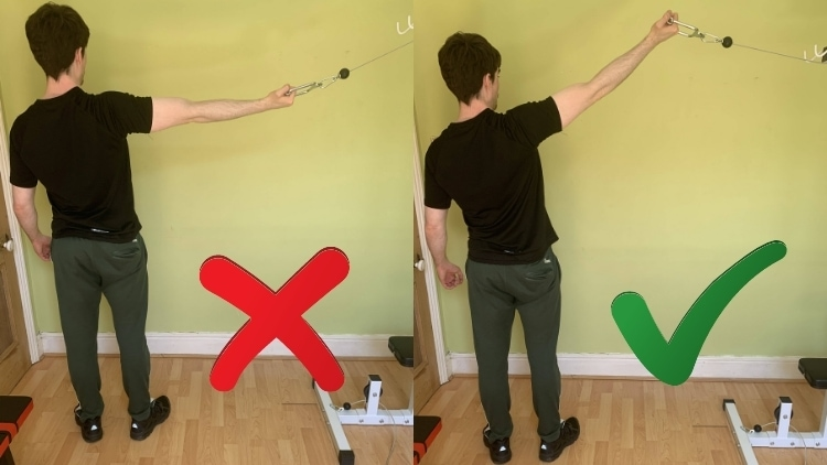 Man performing a one arm high cable curl