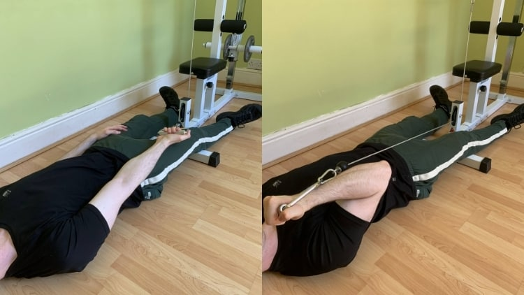 Man performing single arm lying cable curls