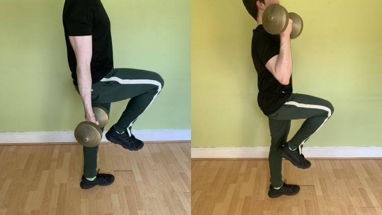 Man doing a one leg bicep curl