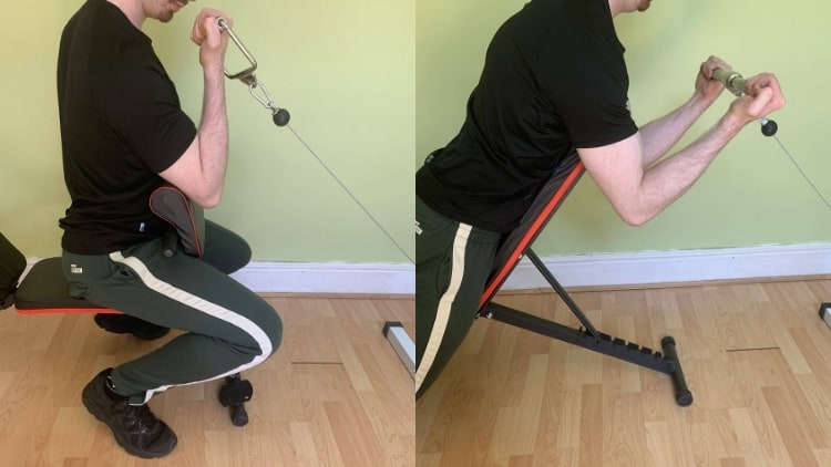 A man demonstrating the difference between spider curls and preacher curls