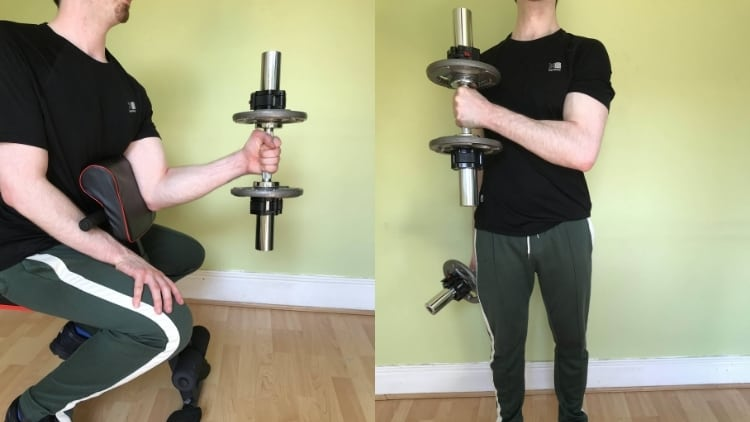 A man demonstrating the differences between hammer curls and preacher curls