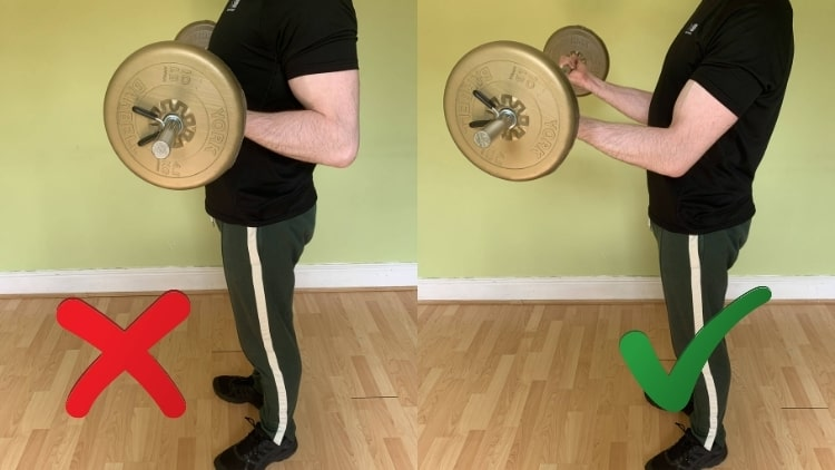 A man showing the proper barbell curl form for training the biceps