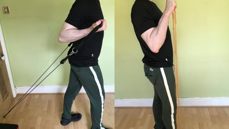 A man performing some exercises during his resistance band bicep workout