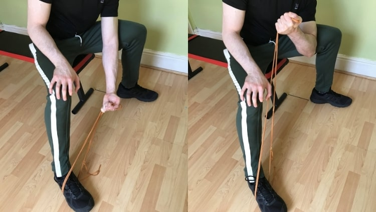 A man doing a resistance band concentration curl